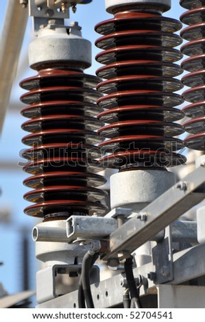 Close up of high voltage insulators at new substation - stock photo