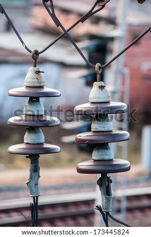 Close up of high voltage insulators at substation - stock photo