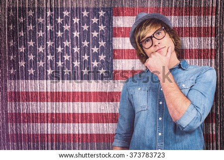 Close up of hipster man thinking against composite image of usa national flag