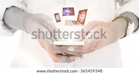 Close up of hipster using his smartphone against abstract technology background - stock photo