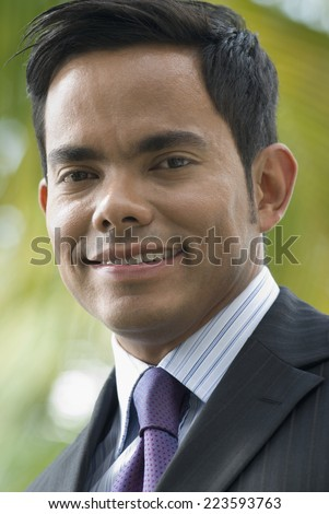 Close up of Hispanic businessman smiling