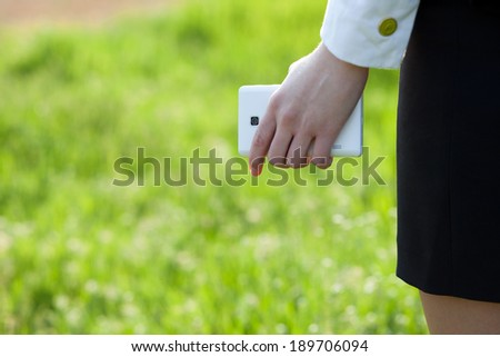 Close up of holding smartphone female hand - stock photo