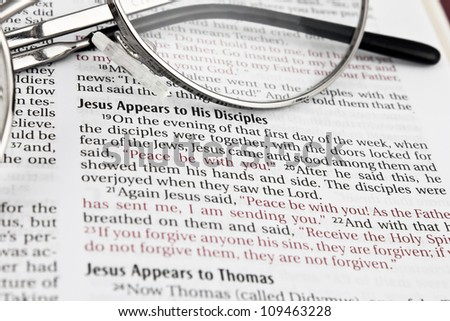 "Close up of Holy bible book, The passage ""Jesus appears to his disciples"". - stock photo"