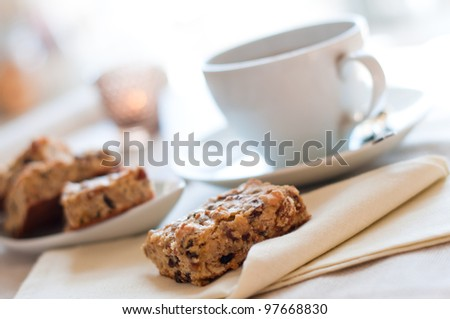 Close-up of home-made biscuits and a cup of tea on the table in the morning - stock photo