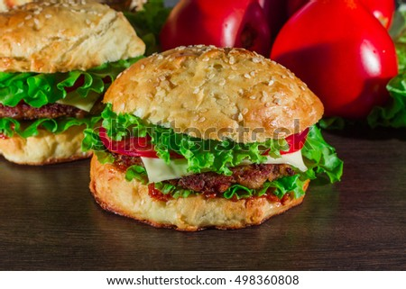 Close-up of home made tasty burgers on wooden table