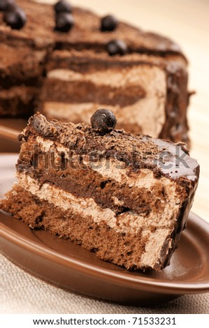 Close-up of homemade chocolate cake on beige background.. - stock photo