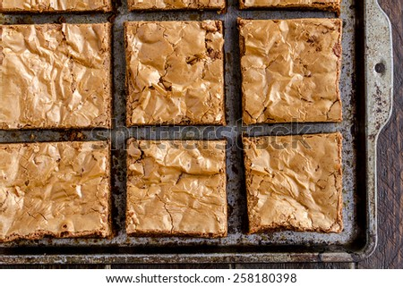 Close up of homemade double chocolate chunk brownies sitting on metal baking pan - stock photo