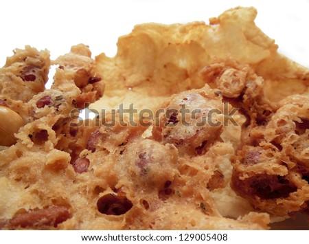 Close-up of homemade rempeyek, deep fried Indonesian peanut cracker and krupuk emping - stock photo
