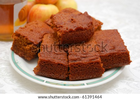 close up of honey cake for Rosh Hashsana with honey and apples