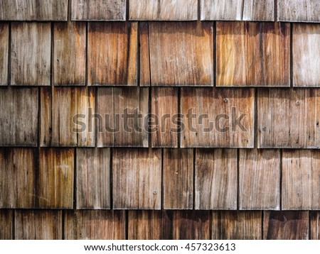 Close up of horizontal image of gray and brown wooden shingles roof for background texture