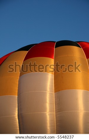 Close up of hot air balloon during early morning ascend - stock photo