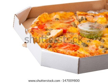 Close up of hot and fresh Supreme Pizza in the delivery box - stock photo