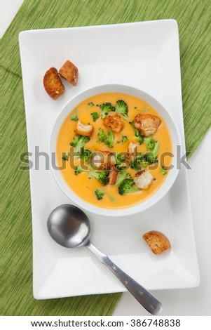 Close up of hot delicious broccoli - cheddar cheese soup with garlic croutons.