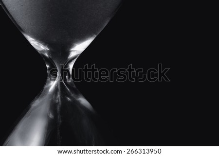 Close up of hourglass. Black white - stock photo