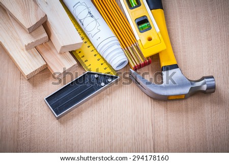 Close up of house-improvement building tools on wooden board construction concept. - stock photo