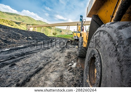 Close up of huge coal mining machines' tires - stock photo