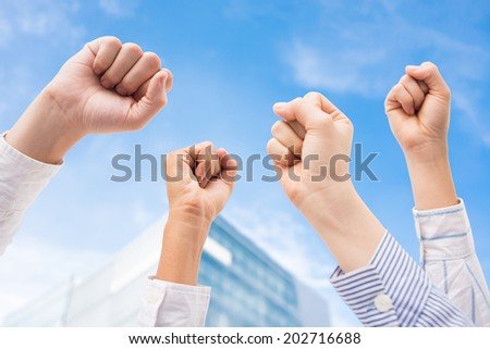 Close-up of human fists as a symbol of success and power - stock photo