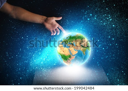 Close up of human hand touching Earth planet with finger. Elements of this image are furnished by NASA - stock photo