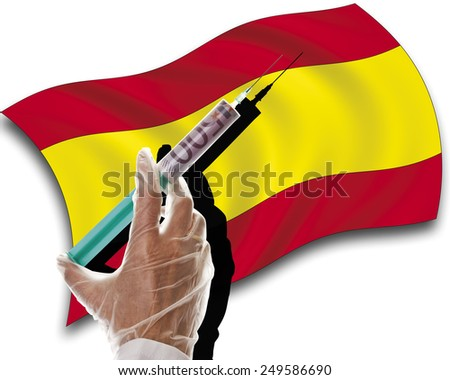 Close up of human hand with cash injection on spanish flag - stock photo