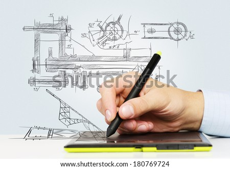 Close up of human hand working with tablet