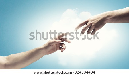 Close up of human hands touching with fingers - stock photo