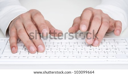 Close up of human hands typing at the keyboard - stock photo