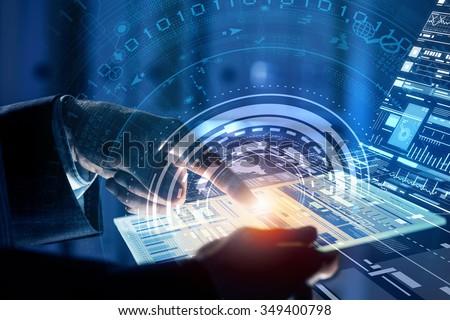 Close up of human hands using virtual panel - stock photo