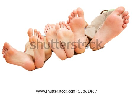 Close-up of human soles relaxing on white background - stock photo