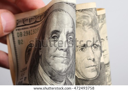 Close-up of hundred, twenty and ten dollars banknotes. Small DOF