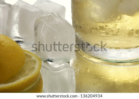 close up of ice cubes and yellow drink - stock photo