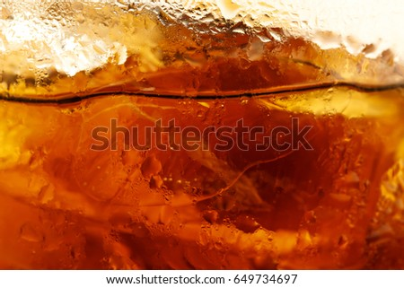 Close up of ice cubes in cola background