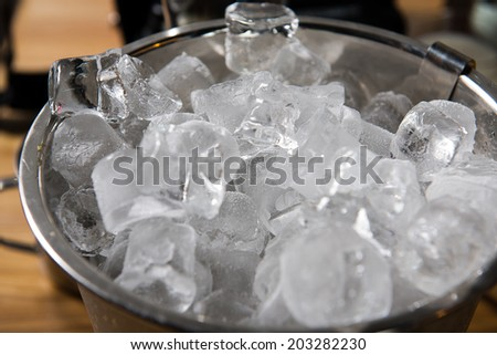 Close-up of Ice cubes in tin bucket  - stock photo