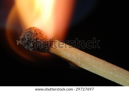 Close-up of igniting match isolated on black - stock photo