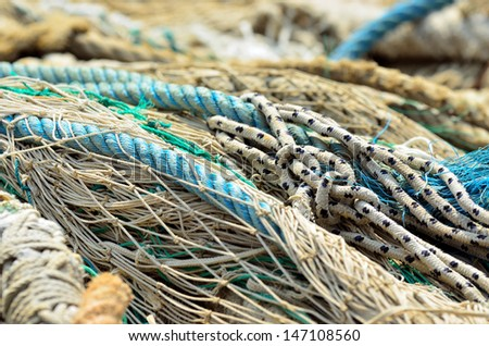 Close up of industrial fishing nets in port - stock photo