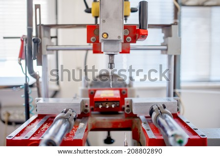 close-up of industrial metal drilling machinery. factory tools and utensils - stock photo
