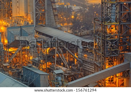 Close-up of industrial pipelines of an oil-refinery plant - stock photo