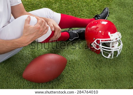 Close-up Of Injured American Football Player On Field - stock photo
