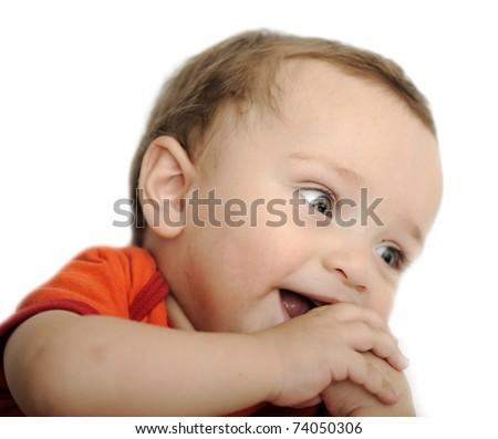 Close-up of innocent baby keeping his fingers in mouth - stock photo