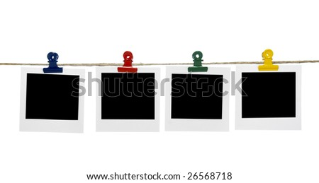 close up of instant film transfer photo on a clothesline on white background with clipping path - stock photo