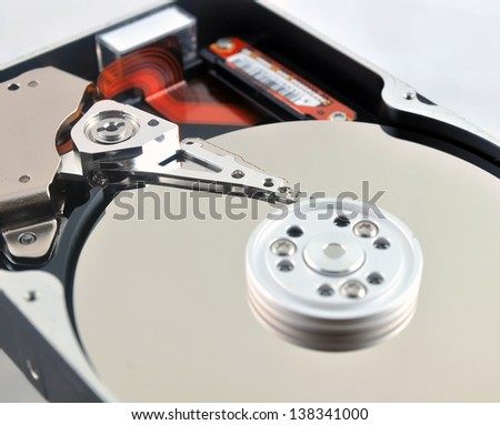 Close-up of internal components of a harddisk drive (HDD) - stock photo