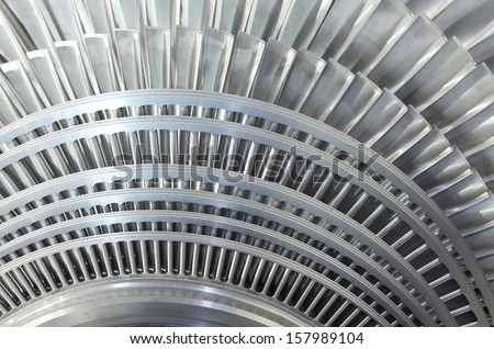 Close up of internal rotor of a steam Turbine - stock photo