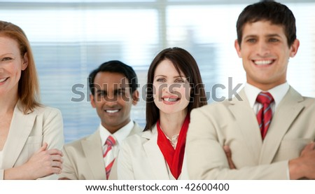 Close-up of international business people with folded arms in a business building