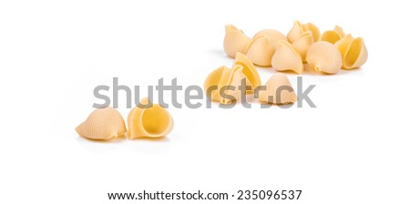 Close up of Italian pasta shells. Isolated on a white background.