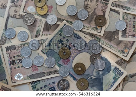 Close up of japan currency banknote and coin on the background.