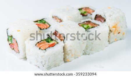 close-up of  Japan sushi white rice, salmon and cucumber (shallow DOF) on a white background - stock photo