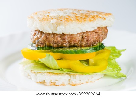close-up of  Japanese food, grilled meat in Rice burger, served on plate (shallow DOF)