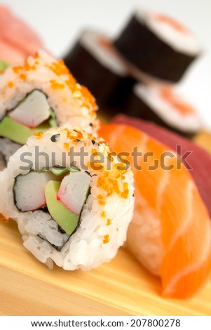close up of japanese sushi on wooden board - stock photo