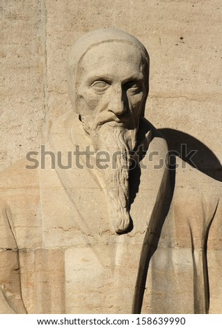 Close up of Jean Calvin statue on reformation wall in Parc Des Bastions, Geneva, Switzerland.
