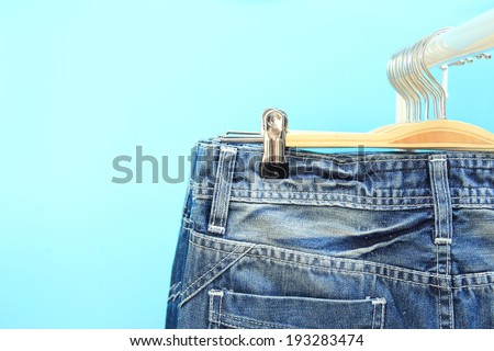 Close-up of jeans on a rack - stock photo