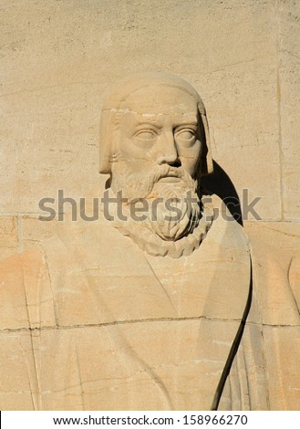 Close up of John Knox statue on reformation wall in Parc Des Bastions, Geneva, Switzerland.